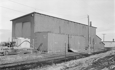 2018.15.N64.2941--ed wilkommen 116 neg--San Luis Central--boxcar 101 and enginehouse--Monte Vista CO--1954 0528