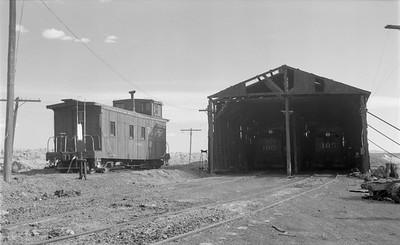 2018.15.N64.2925--ed wilkommen 116 neg--San Luis Valley Southern--caboose and enginehouse scene--Blanca CO--no date