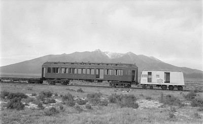 2018.15.N64.2932--ed wilkommen 116 neg--San Luis Valley Southern--motorcar M-300 and wooden coach body scene--Blanca CO--no date
