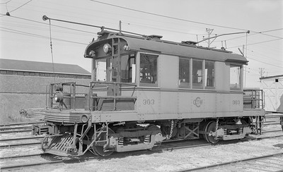 2018 15 N64 2574--ed wilkommen 116 neg--Charles City Western--electric locomotive 303--Charles City IA--1957 0414