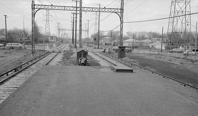 2018.15.N99E.7998--ed wilkommen 116 neg--CTA--Skokie Swift line view from old plaform looking west at Crawford Ave transition point--Skokie IL--1960s. Transition point between third rail and overhead wire.