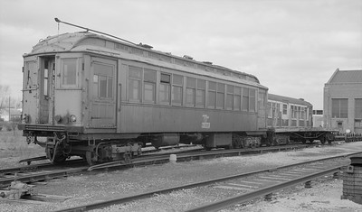 2018.15.N99E.8006--ed wilkommen 116 neg--CTA--wooden work motor S-333 and flatcar at shops--Skokie IL--c1960s. Now undergoing restoration at IRM.