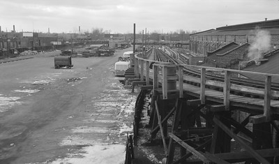 2018.15.N99E.8001--ed wilkommen 116 neg--CTA--Hamilin Yard view (Lake and Hamlin Ave)--Chicago IL--mid 1960s. Shop building at extreme right used for work trains at the time. C&NW Galena Division main in background with ALCO switcher at left.