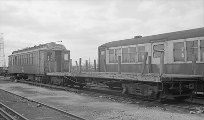 2018.15.N99E.8007--ed wilkommen 116 neg--CTA--flatcar at shops--Skokie IL--c1960s. Car 4067 at right used for supply storage.
