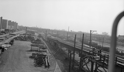 2018.15.N99E.8000--ed wilkommen 116 neg--CTA--63rd Street yard view used for track material storage--Chicago IL--no date. NYC roundhouse at extreme right.
