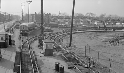 2018.15.N99E.7996--ed wilkommen 116 neg--CTA--54th Ave yard view on Douglas Park line looking west--Chicago IL--mid 1960s. Pullman 2000-series cars at left.