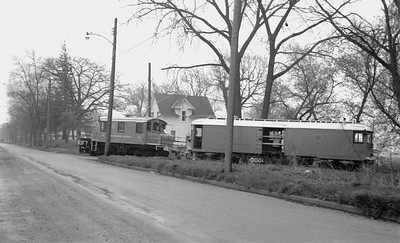 2018.15.N64.2753--ed wilkommen 116 neg--Iowa Terminal--electric locomotive and freight motor entering street--Clear Lake IA--no date