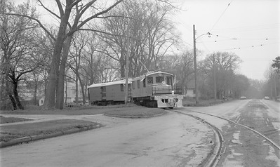 2018.15.N64.2751--ed wilkommen 116 neg--Iowa Terminal--electric locomotive and freight motor entering street--Clear Lake IA--no date