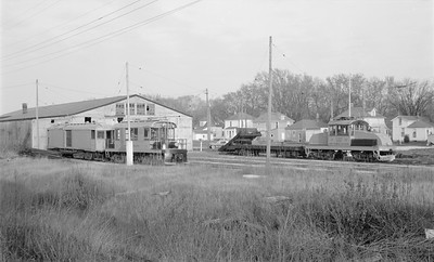 2018.15.N64.2749--ed wilkommen 116 neg--Iowa Terminal--yard scene with electric locomotives and freight motor--Charles City IA--no date