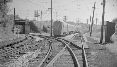 2018.15.N99B.7611--ed wilkommen 116 neg--CNS&M--electric interurban Electroliner passenger train northbound--North Chicago Jct IL--no date. Tracks veering off at left under C&NW are Shoreline Route.