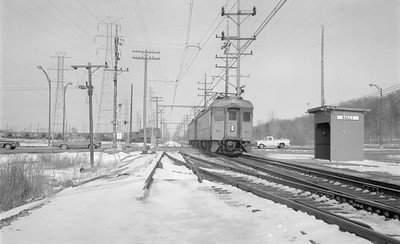 2018.15.N64.2958--ed wilkommen 116 neg--CSS&SB--electric interurban 111 train passing station--Bailly IN--no date