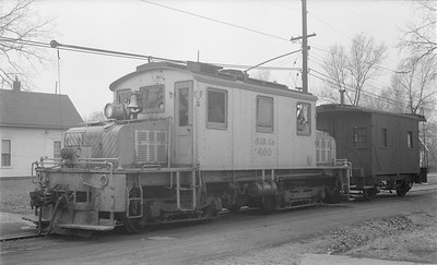 2018.15.N64.2991--ed wilkommen 116 neg--Southern Iowa Rwy--electric locomotive 400 with wooden caboose 102--Centerville IA--1955 0109