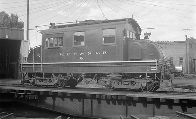 2018.15.N64.3020--ed wilkommen 116 neg--WCF&N--electric locomotive 5 on turntable--Waterloo IA--1954 0718