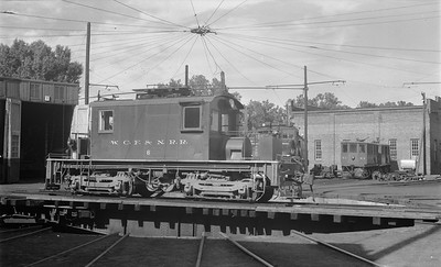 2018.15.N64.3021--ed wilkommen 116 neg--WCF&N--electric locomotive 6 on turntable--Waterloo IA--1954 0718