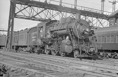 2018.15.N95A.7182--ed wilkommen 6x9 neg--B&A--steam locomotive 2-6-4T 312 on passenger train--Boston MA--1948 0700