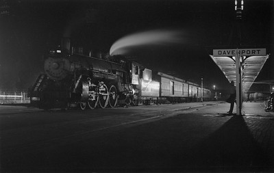 2018.15.N69.5541--ed wilkommen 116 neg--CB&Q--steam locomotive 4-6-2 S-1 2833 on passenger train at station at night--Davenport IA--1953 0815