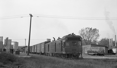 2018.15.N69.5522D--ed wilkommen 116 neg--CB&Q--diesel-electric motorcar 9735 with freight train--Bushnell IL--c1950s 0000