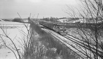 2018.15.N69.7491--ed wilkommen 116 neg--CB&Q--EMD diesel locomotive 9929A on passenger train--location unknown--no date