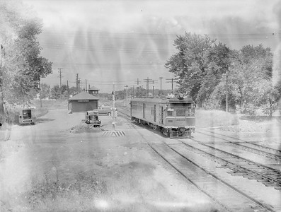 2018.15.N69.7478--ed wilkommen 3x4 neg--CB&Q--gas-electric motorcar on southbound train 12 leaving depot--Christopher IL--1954 1108