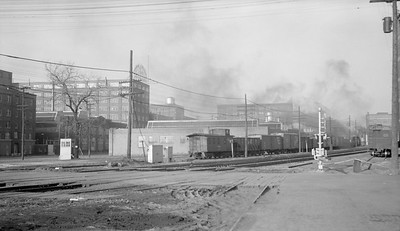 2018.15.N69.7500--ed wilkommen 116 neg--CB&Q--steam freight train scene with caboose--Moline IL--no date