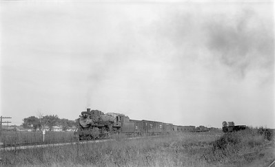 2018.15.N69.5536--ed wilkommen 116 neg--CB&Q--steam locomotive 2-8-2 O-1-A 4990 on freight train action--location unknown--no date