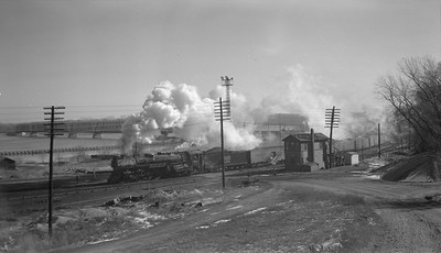2018.15.N69.7486--ed wilkommen 116 neg--CB&Q--steam locomotive 4-8-4 O-5-B 5623 on freight train action--Burlington IA--no date