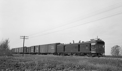 2018.15.N69.5522B--ed wilkommen 116 neg--CB&Q--diesel-electric motorcar 9735 with freight train--near Macomb IL--c1950s 0000