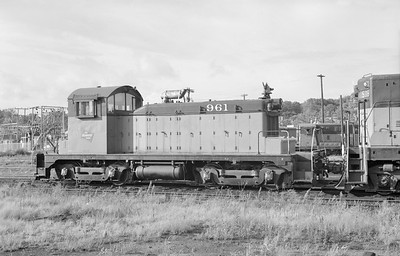 2018.15.N68B.4814F--ed wilkommen 6x9 neg--CMStP&P--EMD switcher diesel locomotive 961--location unknown--no date