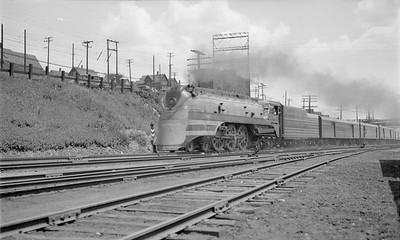 2018.15.N68F.4943--ed wilkommen 116 neg--CMStP&P--steam locomotive 4-6-4 F7 100 on Hiawatha passenger train action--Milwaukee WI--1940 0704