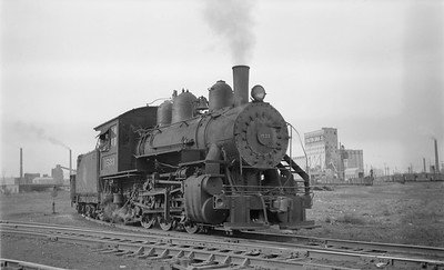 2018.15.N68F.4955--ed wilkommen 116 neg--CMStP&P--steam locomotive 0-6-0 I6 1533 switching in yard--Milwaukee WI--no date