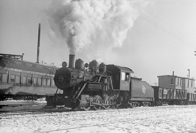 2018.15.N68F.4949--ed wilkommen 6x9 neg--CMStP&P--steam locomotive 0-6-0 1507 switching AO Smith plant using their crew--Milwaukee WI--no date