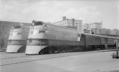 2018.15.N68F.4942--ed wilkommen 116 neg--CMStP&P--steam locomotives 4-4-2 A 4 and 1 on passenger trains at depot--Milwaukee WI--1938 0602