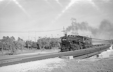 2018.15.N68F.4964--ed wilkommen 6x9 neg--CMStP&P--steam locomotive 4-6-2 F3 on passenger train 23 Menomonee River bridge action--Milwaukee WI--1954 0627