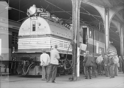 2018.15.N68F.4962--ed wilkommen 6x9 neg--CMStP&P--electric locomotive E-3 in passenger station on display--Milwaukee WI--1949 0500