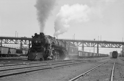 2018.15.N68F.4944--ed wilkommen 6x9 neg--CMStP&P--steam locomotive 4-8-4 S2 204 on freight train in yard action--Milwaukee WI--no date