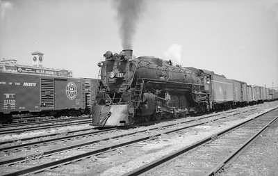 2018.15.N68F.4956--ed wilkommen 6x9 neg--CMStP&P--steam locomotive 4-8-4 S2 237 on freight train passing Washington St tower action--Milwaukee WI--no date