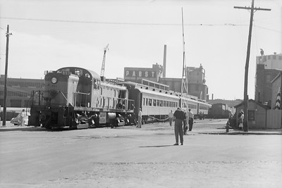 2018.15.N68F.4958--ed wilkommen 6x9 neg--CMStP&P--diesel locomotive ALCO 993 on Beer Line Walnut St with NMRA passenger special--Milwaukee WI--1950 0902