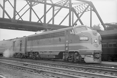 2018.15.N86.6390--ed wilkommen 6x9 neg--C&EI--diesel locomotive EMD 1605 on passenger train--Englewood IL--no date--