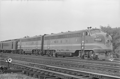 2018.15.N86.6389--ed wilkommen 6x9 neg--C&EI--diesel locomotive EMD 1603 on passenger train--Chicago IL--no date