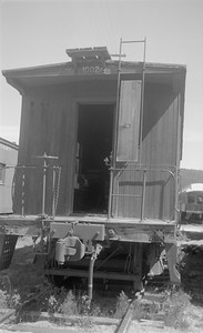 2018.15.N45.1559--ed wilkommen 116 neg--caboose--unknown road--Hill City SD--no date