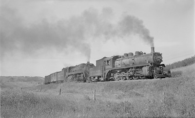 2018.15.N83.6356--ed wilkommen 116 neg--CP--steam locomotive 2-10-0 R3D 5782 and 4-6-2 G3E 2363 doublehead freight traina action--Minnedosa MB--no date