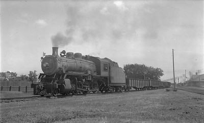 2018.15.N83.6357--ed wilkommen 116 neg--CP--steam locomotive 4-6-0 D10K 1063 on extra freight train leaving mainline--Portage LaPrairie MB--no date
