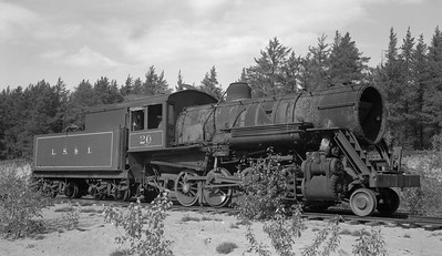 2018.15.N92B.8167--ed wilkommen 116 neg--LS&I--steam locomotive 2-8-0 20 stored at sand pit siding (dead)--Presque Isle MI--c1960s 0000