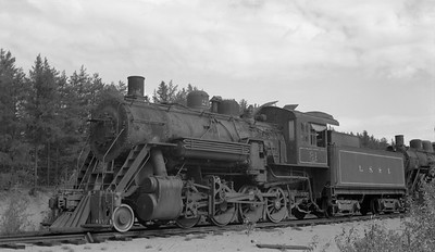 2018.15.N92B.8168--ed wilkommen 116 neg--LS&I--steam locomotive 2-8-0 21 stored at sand pit siding (dead)--Presque Isle MI--c1960s 0000