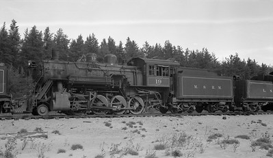 2018.15.N92B.8166--ed wilkommen 116 neg--LS&I--steam locomotive 2-8-0 19 stored at sand pit siding (dead)--Presque Isle MI--c1960s 0000