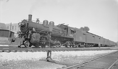 2018.15.N92A.7102--ed wilkommen 116 neg--DSS&A--steam locomotive 4-6-2 H-1 552 on passenger train--Marquette MI--1946 0725