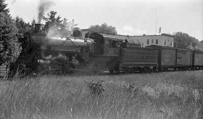 2018.15.N92B.8169--ed wilkommen 116 neg--LS&I--steam locomotive 2-8-0 21 on freight train--Munising MI--1946 0725