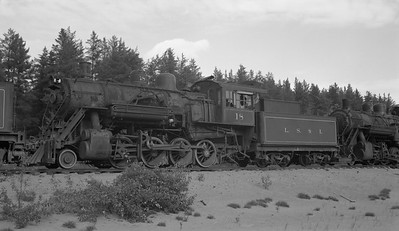 2018.15.N92B.8165--ed wilkommen 116 neg--LS&I--steam locomotive 2-8-0 18 stored at sand pit siding (dead)--Presque Isle MI--c1960s 0000