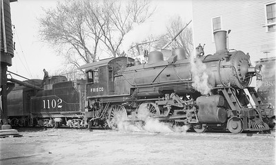 2018.15.N89.6525--ed wilkommen 116 neg--SLSF--steam locomotive 4-6-0 1102 on passenger train taking water--Harrisonville MO--1948 0101