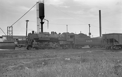 2018.15.N87.6403H--ed wilkommen 6x9 neg--ICRR--steam locomotive 2-8-2 1225 at sand tower--location unknown--no date